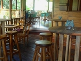 Our cozy bar area during the day; great for relaxing and enjoying one of our fresh tropical juices.